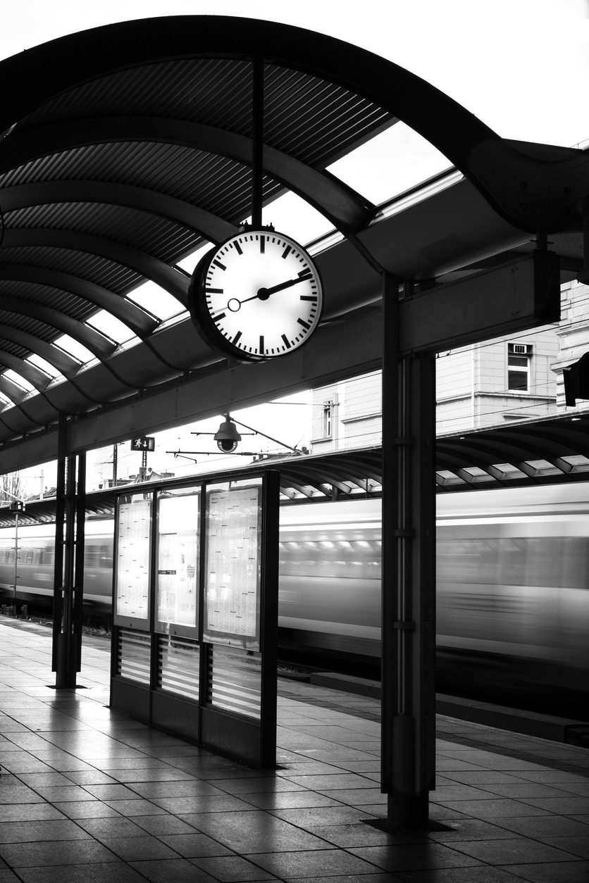Time table, clock and train